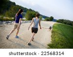 Stock photo two friends walking a dog 22568314