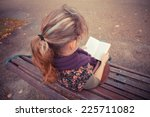 a young woman is sitting on a... | Shutterstock . vector #225711082