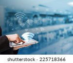 businesswoman connecting to wifi | Shutterstock . vector #225718366