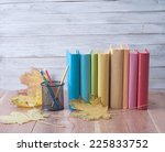 books on a wooden  background. | Shutterstock . vector #225833752