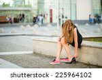 young woman changes shoes on... | Shutterstock . vector #225964102