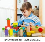 serious child playing with toys ...   Shutterstock . vector #225980182