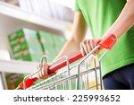 woman in green t shirt pushing... | Shutterstock . vector #225993652