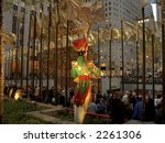 The tree, a wooden soldier decoration, golden flags and colorful lights attracts thousands of people to Rockefeller Center during the holidays. - stock photo