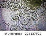 raindrops falling in water | Shutterstock . vector #226137922
