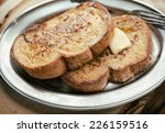 Two Pieces Of French Toast Wit...