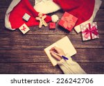 female writing wish list in to... | Shutterstock . vector #226242706