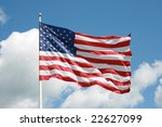 us flag against a bold blue sky ... | Shutterstock . vector #22627099