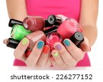 nail polish in hand  close up | Shutterstock . vector #226277152