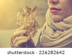 woman with autumn leaf in hand | Shutterstock . vector #226282642