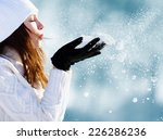 girl playing with snow in park | Shutterstock . vector #226286236