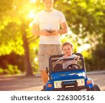 father with son playing with... | Shutterstock . vector #226300516