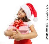 Child Holding Christmas Gift...