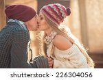 two lovers kissing on the street | Shutterstock . vector #226304056