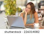 serious woman watching a laptop ... | Shutterstock . vector #226314082
