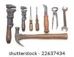 Group of antique hand tools on white background with slight shadows - stock photo