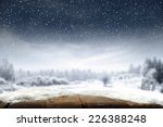 xmas day and desk of wood in... | Shutterstock . vector #226388248