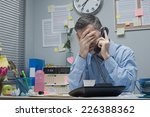 stressed employee on the phone... | Shutterstock . vector #226388362