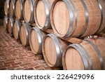 wine barrels stacked in the old ... | Shutterstock . vector #226429096