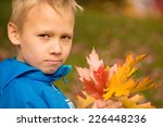 serious school aged boy with a... | Shutterstock . vector #226448236