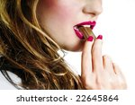 Sexy girl eating chocolate young pretty woman / model / student / businesswoman / secretary with pink lips, vintage / retro / lips / seductive - closeup - stock photo