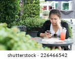 woman on phone drinking... | Shutterstock . vector #226466542