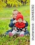 brother and sister on the fall... | Shutterstock . vector #226483282