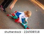 beautiful girl riding a scooter ... | Shutterstock . vector #226508518