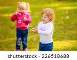 happy kids with soap bubbles in ... | Shutterstock . vector #226518688
