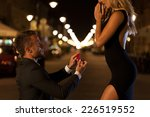 a man in a suit proposing to... | Shutterstock . vector #226519552