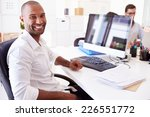 businessman at computer in... | Shutterstock . vector #226551772