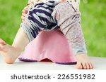 children's legs hanging down... | Shutterstock . vector #226551982