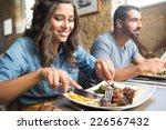 couple having lunch at rustic... | Shutterstock . vector #226567432