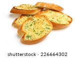 garlic and herb bread slices on ... | Shutterstock . vector #226664302