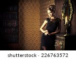 elegant young woman in black... | Shutterstock . vector #226763572