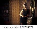 elegant young woman in black... | Shutterstock . vector #226763572