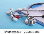stethoscope  pills and bottles... | Shutterstock . vector #226838188
