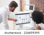two photo editors at work in... | Shutterstock . vector #226859395