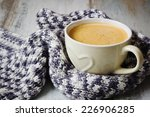 warm wool scarf and coffee cup... | Shutterstock . vector #226906285