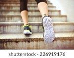 Female Runner Running Up The...