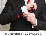 the man clasps a cuff link on a ... | Shutterstock . vector #226961932