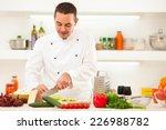 male chef preparing vegetables... | Shutterstock . vector #226988782