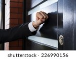 close up of hand knocking on... | Shutterstock . vector #226990156