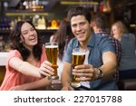 young couple having a drink... | Shutterstock . vector #227015788