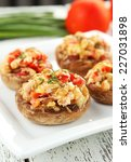 stuffed mushrooms on plate on... | Shutterstock . vector #227031898