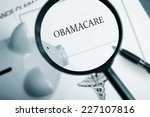 magnifying glass over obamacare ... | Shutterstock . vector #227107816