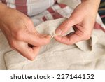 woman hands sewing with needle... | Shutterstock . vector #227144152