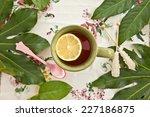 Tea In A Green Mug With A Slic...