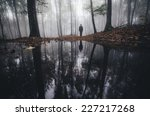 Man Reflection In Lake In...