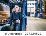 Man Driving A Forklift Through...